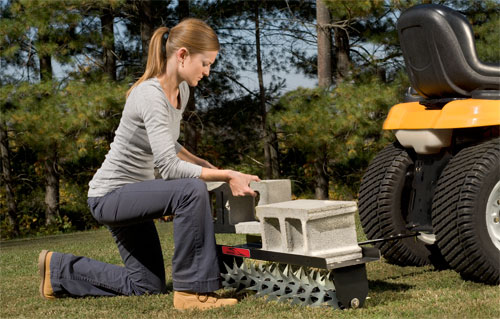 Brinly spike aerator with weight tray